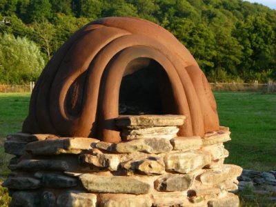 Commission in Onny Meadows - Cob built pizza oven on lime mortared river stone base