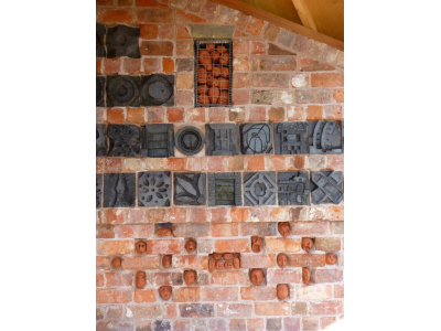 Detail of brick carvings and heads made in ceramic workshops