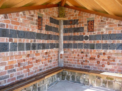 Carved brickwork inside the Bus shelter Cross House, Shropshire