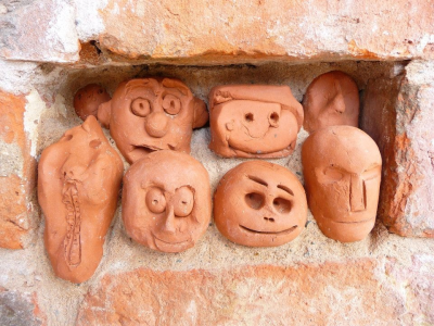 Clay heads in brick work