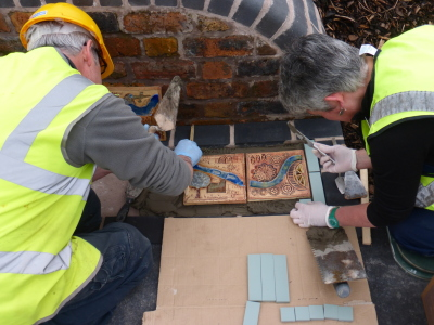 Huw and Ruth laying tiles