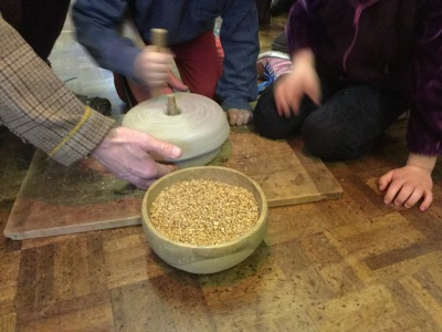 grinding corn using a quern