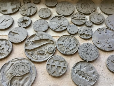 Clay Tiles carved by pupils drying