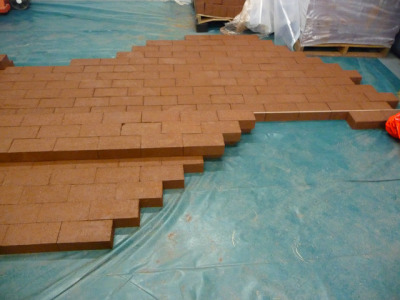 Laying out wet bricks in store room